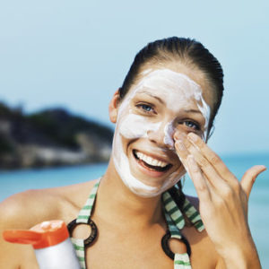 woman applying sunscreen to face 700x700 Getty 200568845 001